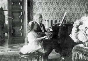 Gabriel Faure playing piano four hands with Mlle. Lombard, 1913